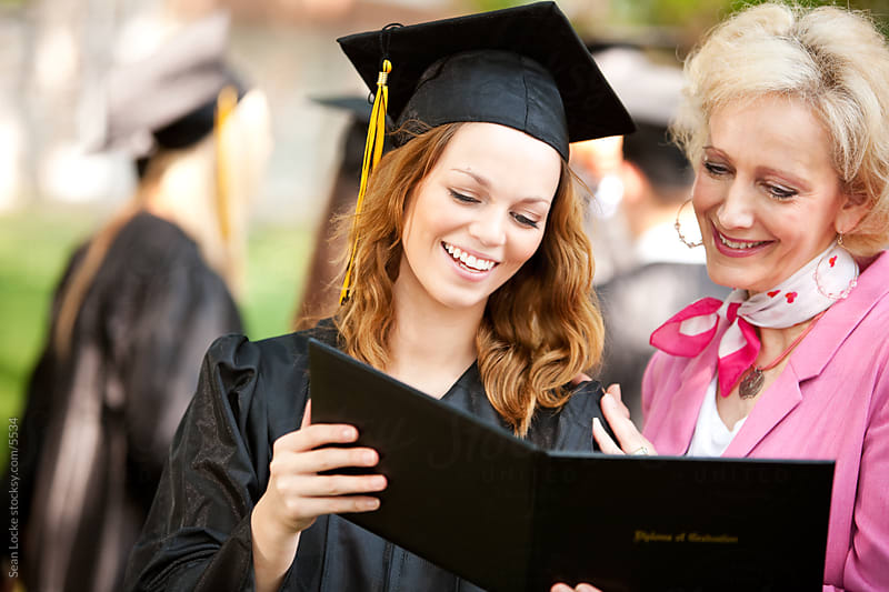 Graduation: Daughter Shows Mother New Diploma by Sean Locke for Stocksy United