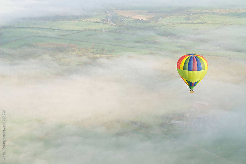 Hot Air Ballooning above Foggy Valley by Adrian P Young for Stocksy United