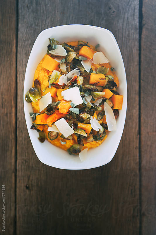 Polenta: Bowl Of Pumpkin Polenta With Roasted Vegetables And Parmesan by Sean Locke for Stocksy United