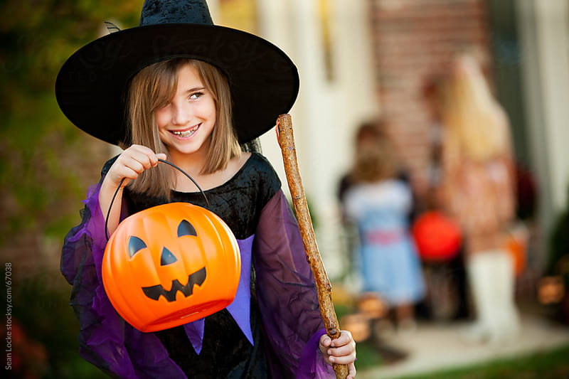Halloween: Little Witch Likes Halloween Candy by Sean Locke for Stocksy United