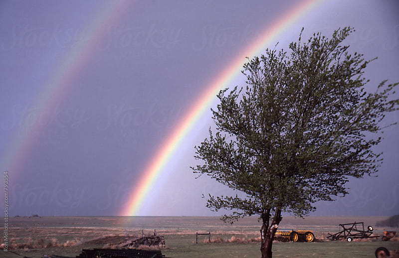 Double rainbow over prairies of southeastern Colorado by Ron Mellott for Stocksy United
