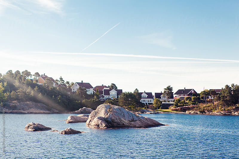 Seaside cottages along the coast in Norway by Cindy Prins for Stocksy United