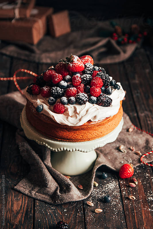 Beautiful cake with cream and fresh fruit by Nataša Mandić for Stocksy United