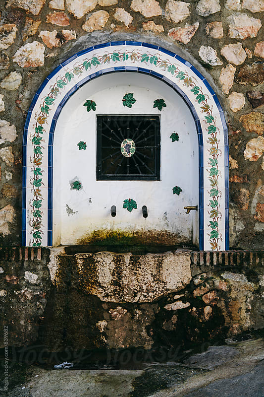 Old traditional water fountain in a small village in Malaga  by kkgas for Stocksy United