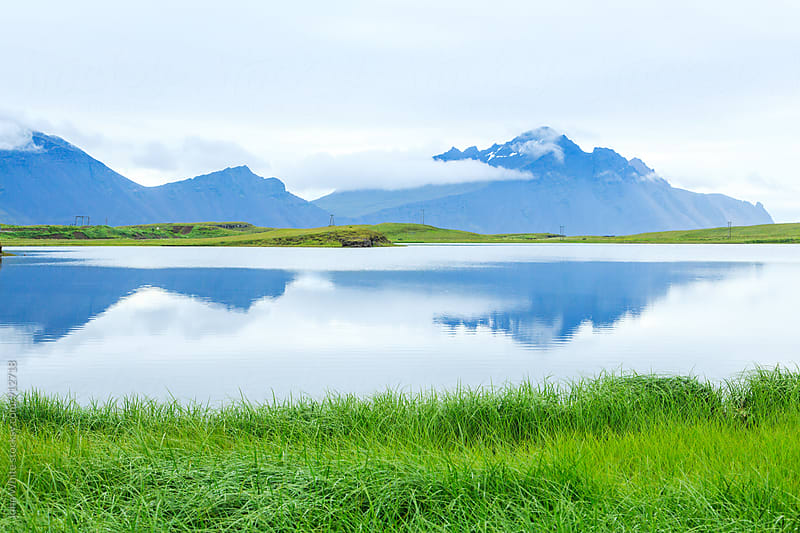 Reflection of mountains at Hofn. Iceland. by John White for Stocksy United
