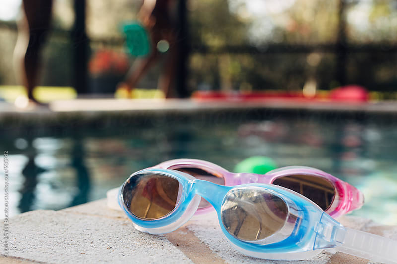 Swim goggles on the side of a pool by Gabriel (Gabi) Bucataru for Stocksy United