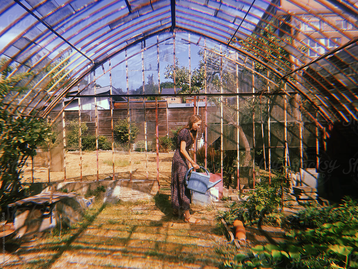 A Beautiful Woman In A Greenhouse | Stocksy United