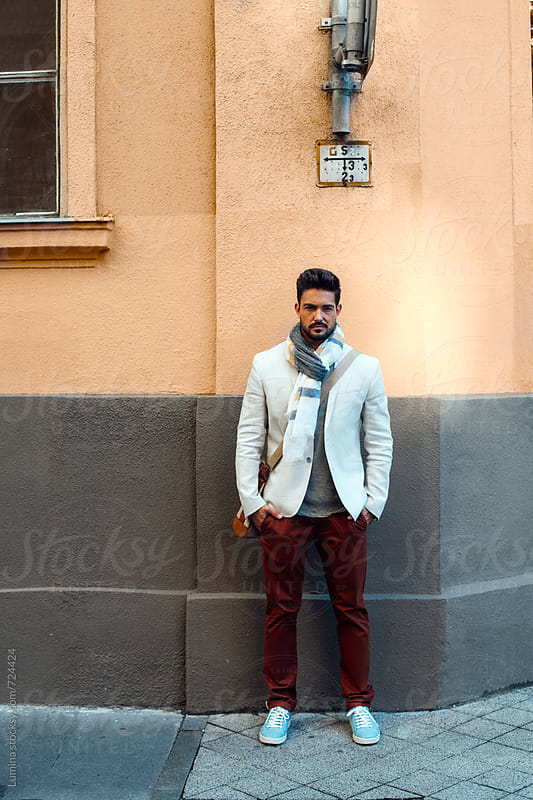 Handsome Man Standing on the Street by Lumina for Stocksy United