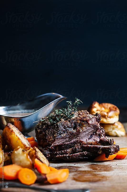 Roast beef dinner.  by Darren Muir for Stocksy United