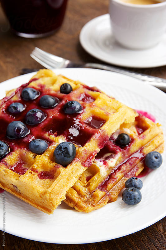 Polenta waffles with berries by Harald Walker for Stocksy United