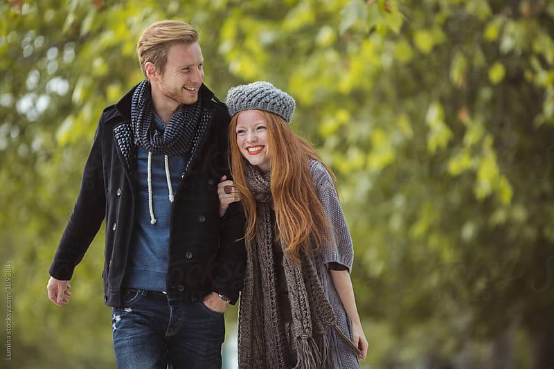 Happy Couple Having a Walk by Lumina for Stocksy United