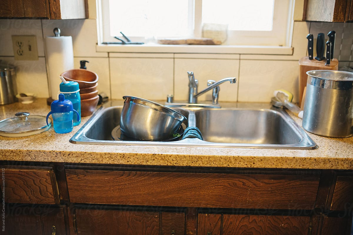 Dirty Dishes In Kitchen Sink | Stocksy United