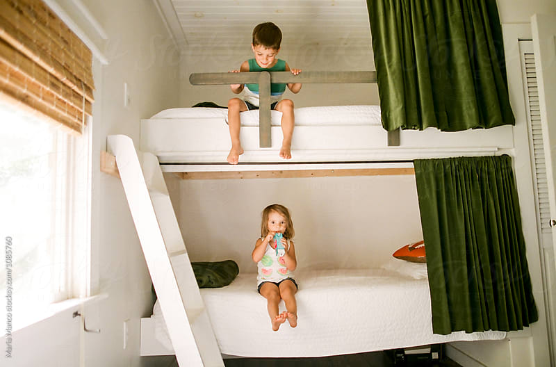 kids on bunk bed by Maria Manco for Stocksy United