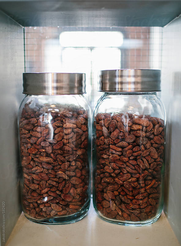 Jars of cocoa beans by Jakob for Stocksy United