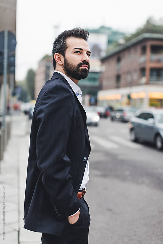 Businessman waiting for the Bus by Mauro Grigollo for Stocksy United