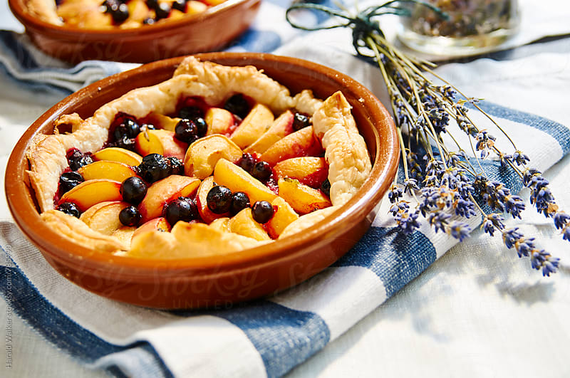 Apricot Almond Tart with Blackcurrants and Lavender Syrup by Harald Walker for Stocksy United