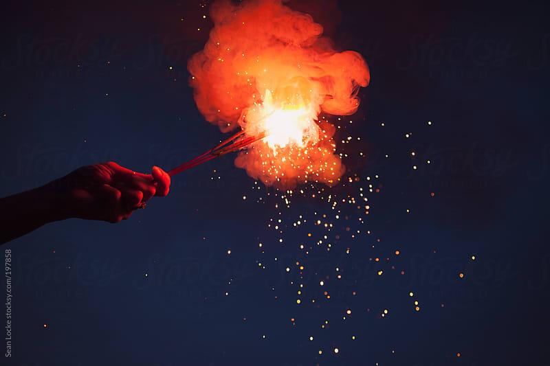Fireworks: Hand Holding Sparkler To Celebrate by Sean Locke for Stocksy United