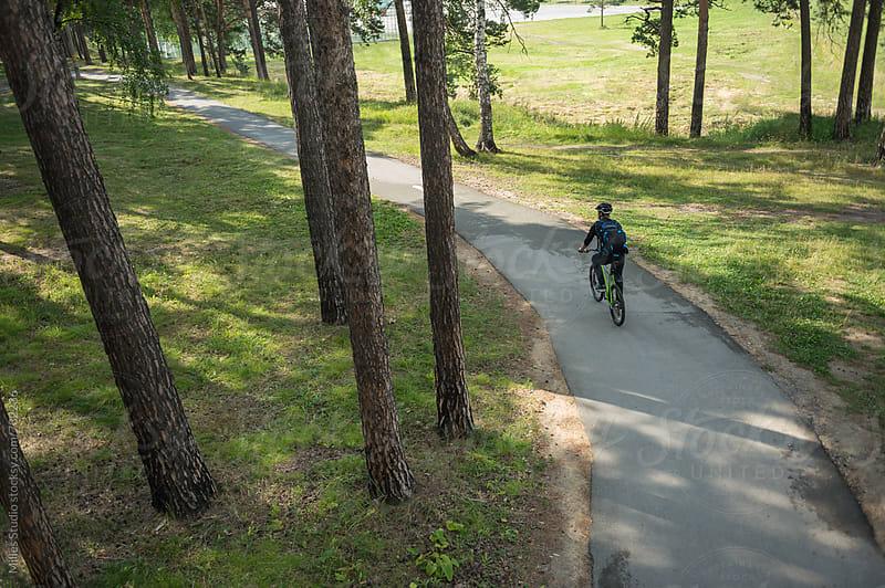 Man riding bike by Milles Studio for Stocksy United