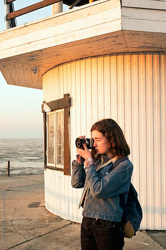 Girl taking photograph in morning by Danil Nevsky for Stocksy United