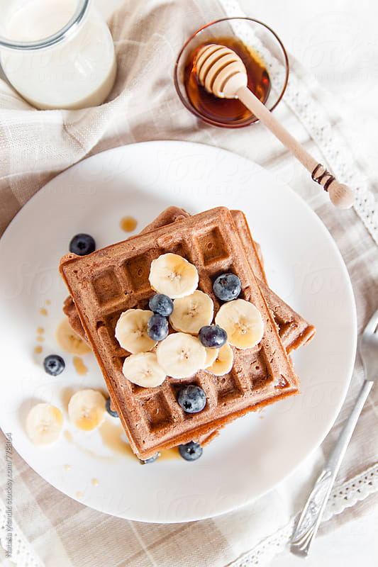 Homemade waffles with banana and blueberries by Nataša Mandić for Stocksy United