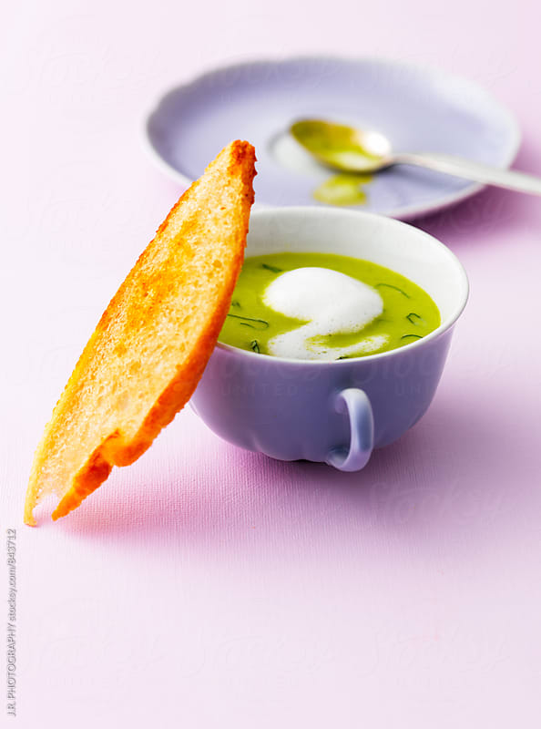 Minted cream of pea soup with toast by J.R. PHOTOGRAPHY for Stocksy United