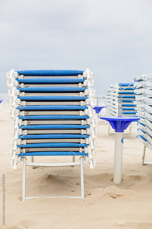 Stack of loungers on the beach by michela ravasio for Stocksy United