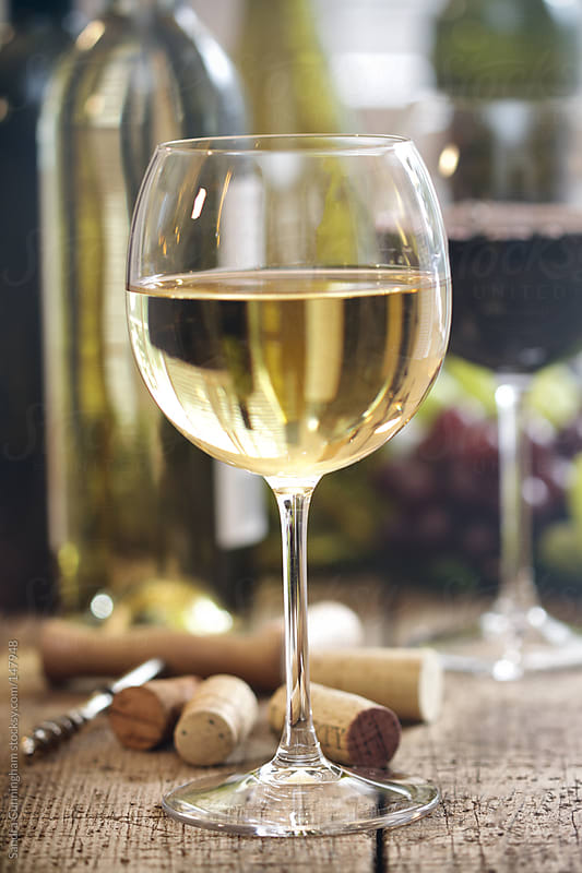 Closeup of a glass of white wine  by Sandra Cunningham for Stocksy United