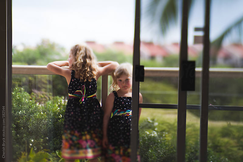 Sisters wearing matching dresses. by Cherish Bryck for Stocksy United