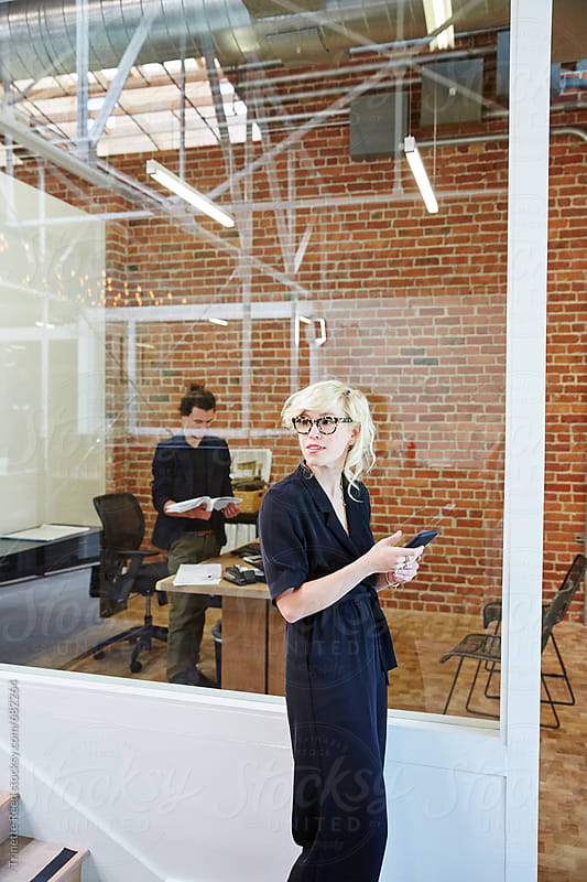 Millennial business people at office  by Trinette Reed for Stocksy United