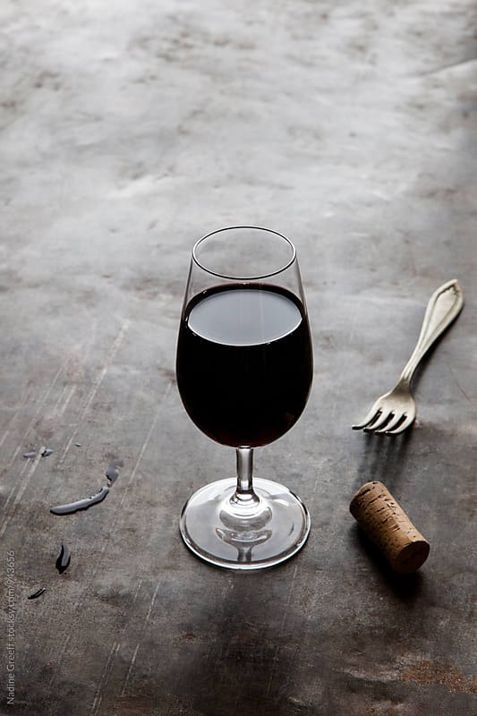 Glass of red wine, cork and fork by Nadine Greeff for Stocksy United
