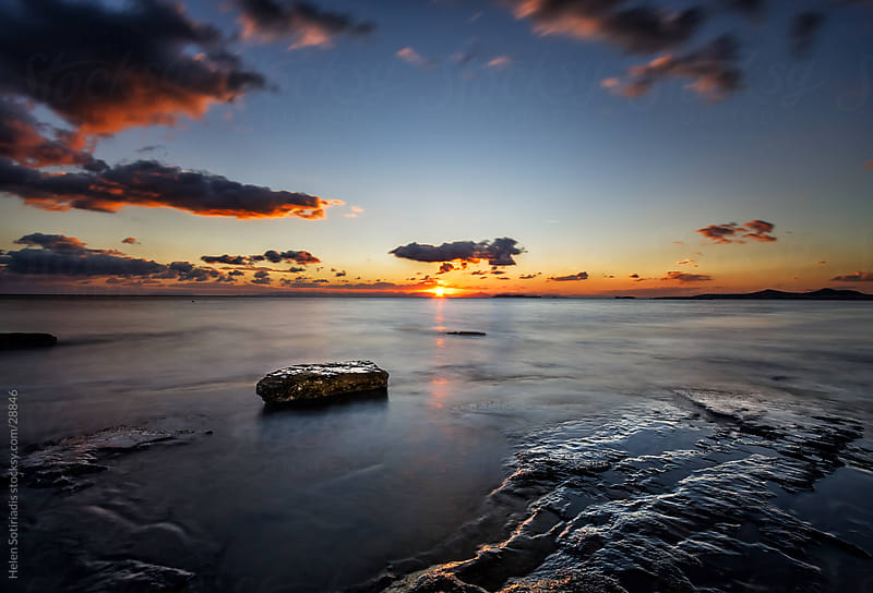 sunset over the sea by Helen Sotiriadis for Stocksy United