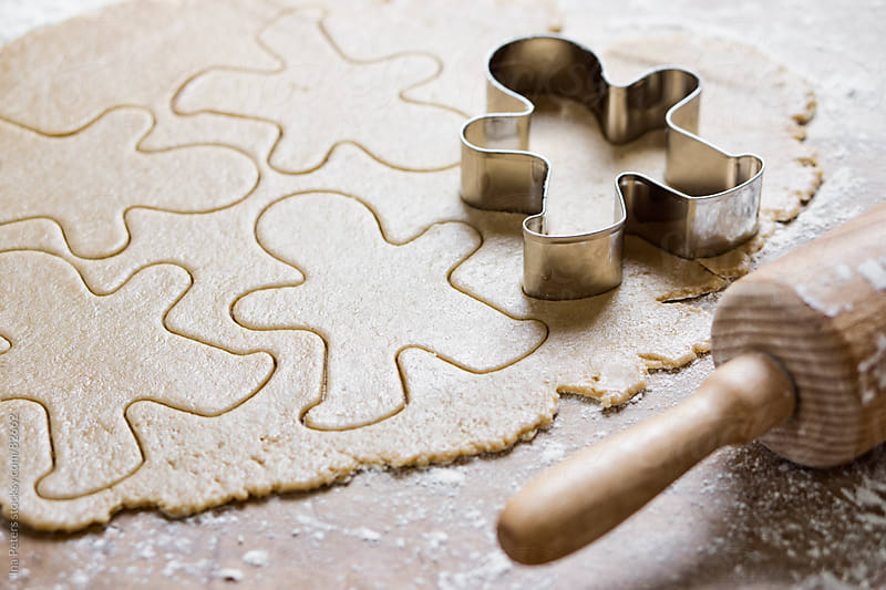 Food: Raw Gingerbread Man cookies by Ina Peters for Stocksy United