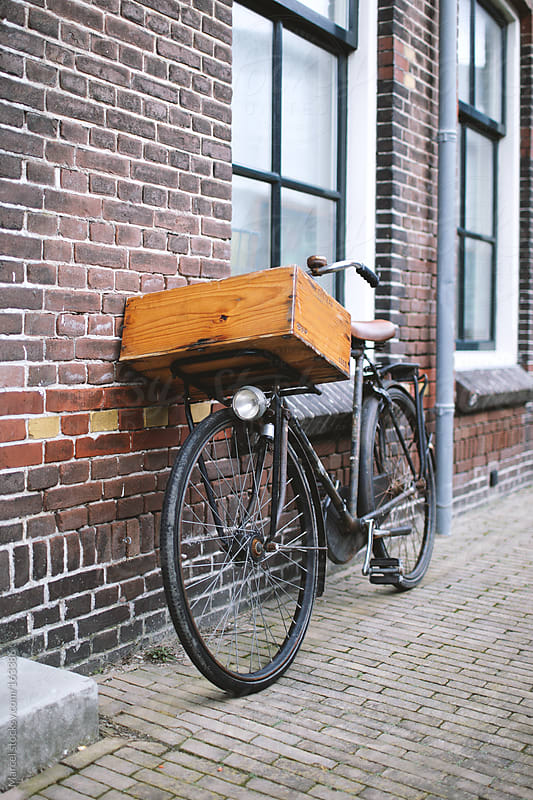 Old bicycle with wooden crate by Marcel for Stocksy United