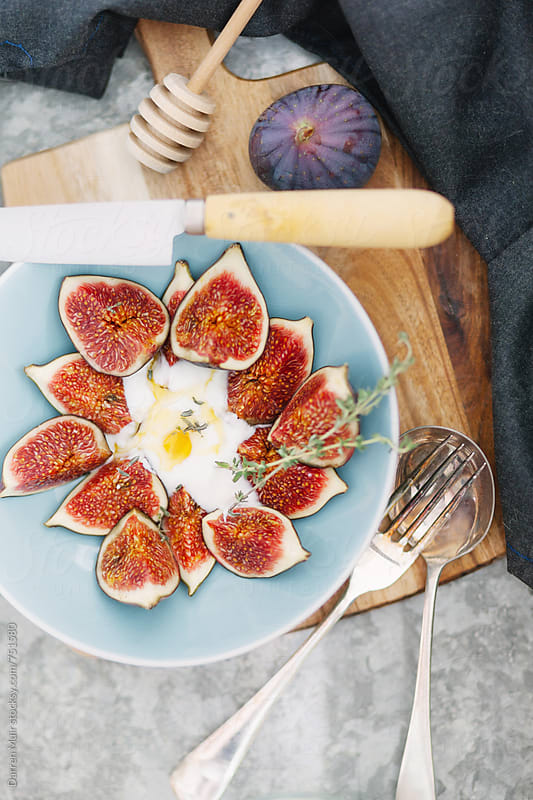 Figs with yogurt and honey. by Darren Muir for Stocksy United