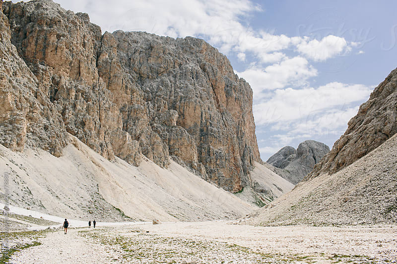 Hikers in a mountain valley by michela ravasio for Stocksy United