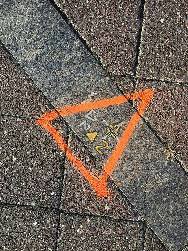 Close up of markings on sidewalk by Paul Edmondson for Stocksy United