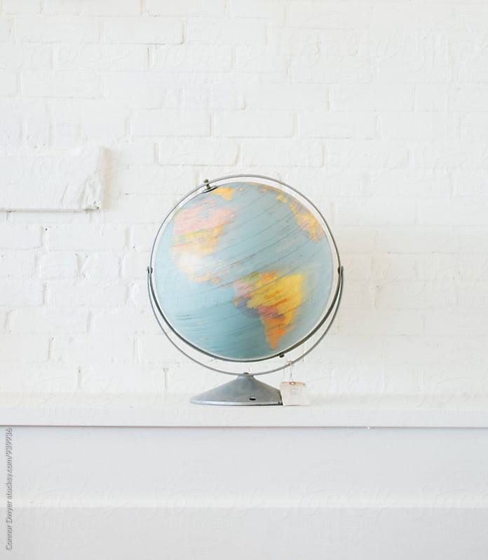Spinning Globe by Connor Dwyer for Stocksy United