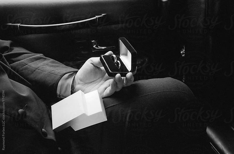 Best Man Holding Rings in Limo on Way to Church by Raymond Forbes LLC for Stocksy United