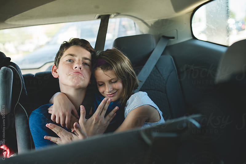 Sibling road trip love  by Courtney Rust for Stocksy United