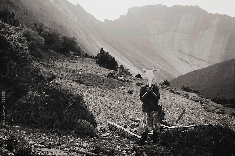 girl holding buffalo skull by Alexander Grabchilev for Stocksy United