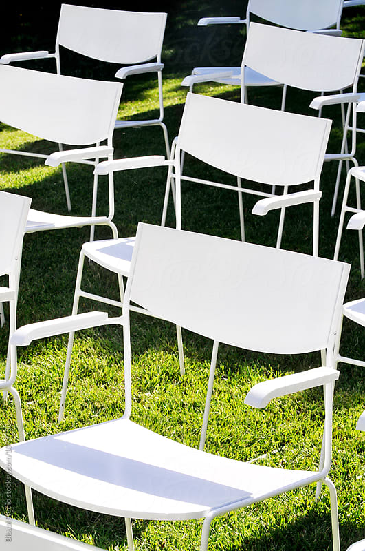 White garden chairs on a wedding by Bisual Studio for Stocksy United