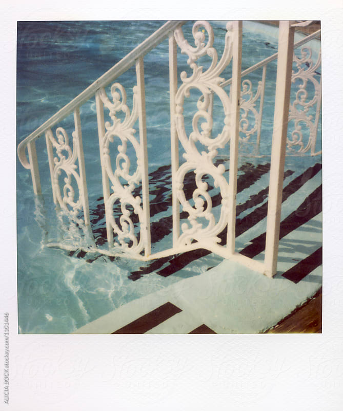 Ornate Swimming Pool Railing Photographed With Expired Polaroid Film by ALICIA BOCK for Stocksy United