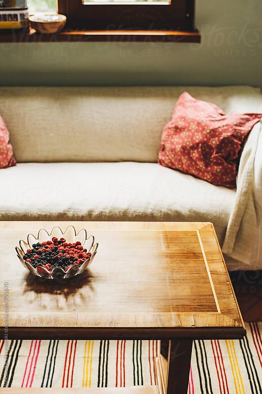 Cosy living room in eclectic interior by Aleksandar Novoselski for Stocksy United