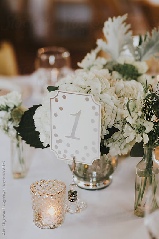 Barn Wedding Reception Table Number and Bouquet by Alicia Magnuson Photography for Stocksy United