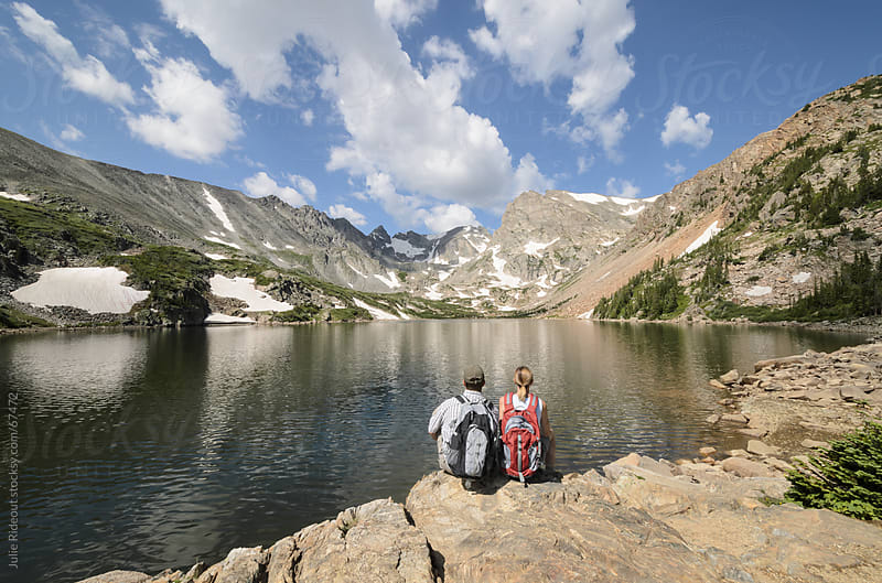 Hikers Enjoying the View at Lake Isabelle, Colorado by Julie Rideout for Stocksy United