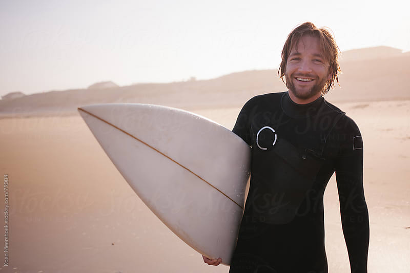 Surfer smiling after a good morning surf in France by Koen Meershoek for Stocksy United