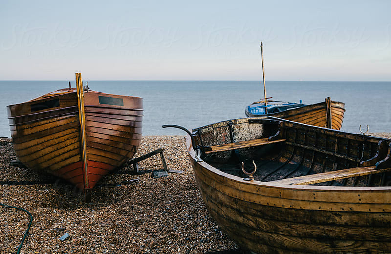 Traditional small wooden fishing boat on the shore. by kkgas for Stocksy United