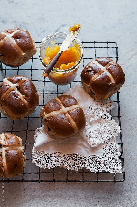 Hot cross buns with a pot of jam by Nadine Greeff for Stocksy United