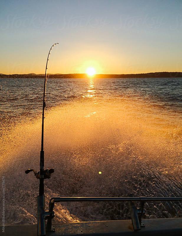 Fishing rod on a boat with golden ocean spray at sunrise by Mihael Blikshteyn for Stocksy United