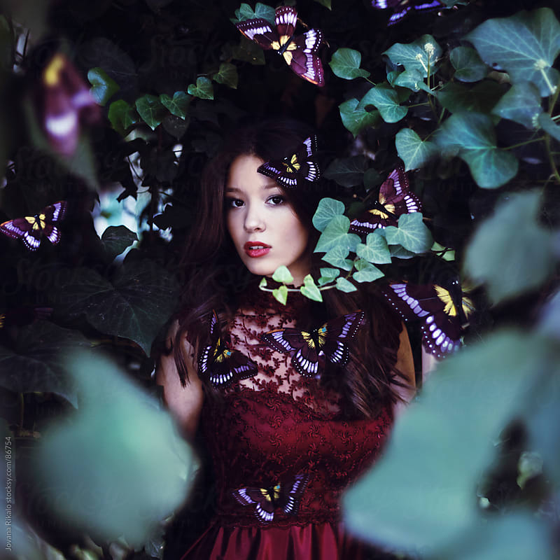 Young beautiful girl surrounded by butterflies by Jovana Rikalo for Stocksy United
